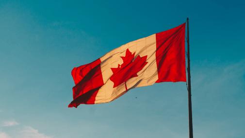 Canadian flag on blue sky