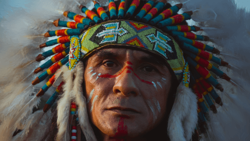 Portrait of american indian man with headress