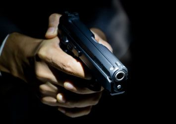 Hands holding pistol