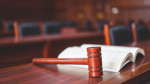 Gavel and law book in a courtroom