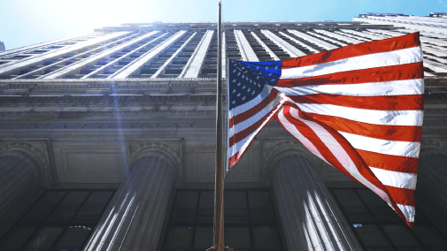 United States flag with legal building