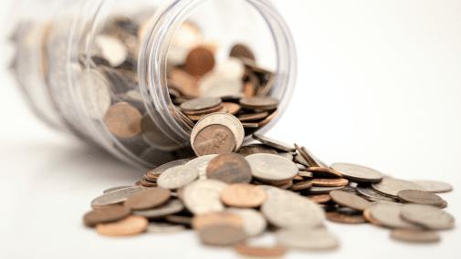 Overturned jar of coins