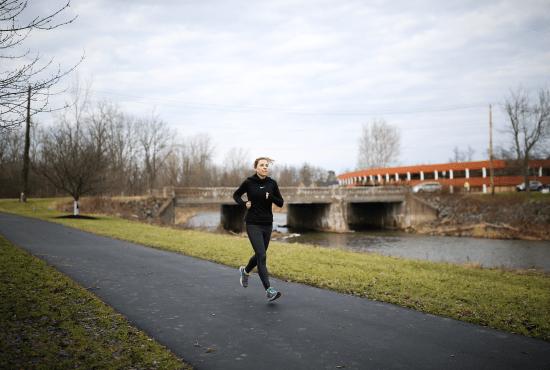 HeinOnline employee running on bike path